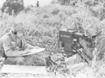 Two airborne troopers with ground radar set.png