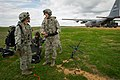 U.S. Air Force Airman 1st Class Cameron Alexander, right, a radio frequency transmission specialist with the 375th Aeromedical Evacuation Squadron (AES), Scott Air Force Base, Ill., and Lt. Col. Monsita Faley 140314-F-XL333-220.jpg