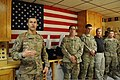 U.S. Air Force Brig. Gen. Joseph T. Guastella Jr., left, the commander of the 455th Air Expeditionary Wing (AEW), speaks at the dedication of a new cafe in the Craig Joint Theater Hospital at Bagram 130424-F-ZX232-023.jpg