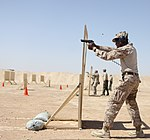 U.S. Marine Corps Capt. Orlando Higgins, foreground, with Regional Command Southwest, fires an M9 pistol Oct. 3, 2013, during a weapons marksmanship course at Camp Leatherneck, Afghanistan 131003-M-DE426-002.jpg