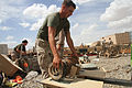 U.S. Marine Corps Lance Cpl. Christopher Caputo, a sorter with General Support 2 Platoon, Retrograde Operations Company, Redeployment and Retrograde in Support of Reset and Reconstitution Operations Group 130411-M-CT526-612.jpg