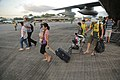 U.S. Marines with the 3rd Marine Expeditionary Brigade assist personnel displaced by Typhoon Haiyan from a KC-130J Super Hercules aircraft and toward the terminal at Villamor Air Base, Metro Manila, Philippines 131112-M-DG262-191.jpg