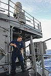 U.S. Navy Cryptologic Technician (Technical) 1st Class Jason Dunkley pressure washes the deck aboard the guided missile cruiser USS Monterey (CG 61) in the Atlantic Ocean Jan. 2, 2014 140102-N-QL471-159.jpg