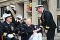 U.S. Navy Rear Adm. Patrick J. Lorge, right, the commandant of Naval District Washington, presents retired Marine Corps Maj. Albert Grasselli, a Pearl Harbor survivor, with a coin 121207-A-IA524-103.jpg