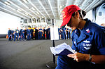 U.S. Navy Ship's Serviceman 1st Class Laura Clarke records team scores during a damage control olympics competition June 10, 2013, aboard the aircraft carrier USS George H.W. Bush (CVN 77) in the Atlantic 130610-N-XE109-086.jpg