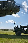 U.S. Soldiers of the 390th Seaport Operations Company (SPOC) get ready to connect a reach pendant on a Humvee to a CH-47 Chinook helicopter during joint-service SPOC 13-2 training exercise at Joint Base 130804-A-GT254-005.jpg