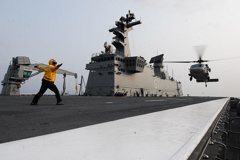 USN MH-60S is landing on the flight deck of the ROKS Dokdo (LPH 6111)