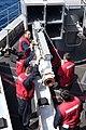 USS Harry S. Truman (CVN 75) sailors load a missile into a NATO Sea Sparrow Surface Missile System-3.jpg