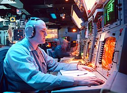 Combat Information Center (CIC) consoles aboard USS Normandy, 1997.