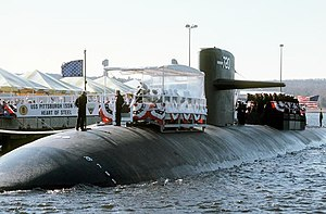 USS Pittsburgh (SSN-720) participates in a dockside ceremony.  Note the USN jack waving from the front of the sub.