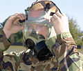 US Air Force (USAF) Airman First Class (A1C) Charles Wortham, 81st Transportation Squadron (TRS), makes an adjustment to his MCU-2P gas mask during a chemical warfare exercise conducted at Kessler Air Force Base 012303-F-BD983-001.jpg