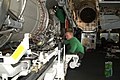 US Navy 030303-N-9228K-012 Super Hornet maintenance in ship's hangar bay.jpg