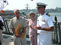 US Navy 030705-N-1234M-001 Lt. Cmdr. Robert DuMont, Executive Officer USS Steven W. Groves (FFG 29), provides Dr. Dick and Mrs. Shirley Groves a tour of USS Steven W. Groves (FFG 29) during their five-day port visit as part of.jpg
