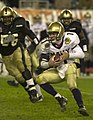 US Navy 031206-N-9693M-505 Navy quarterback Craig Candeto looks for an opening as he rushes downfield during the 104th Army Navy Game.jpg