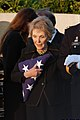 US Navy 040611-N-1450G-059 Former First Lady Nancy Reagan holds onto the flag that covered former President Ronald Reagan's casket as she departs.jpg