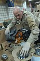 US Navy 050301-N-6027E-001 Fire Controlman 2nd Class Jeffrey Oberts of San Diego, Calif., performs a customs inspection on a U.S. Army Soldier's duffle bag at Camp Doha, Kuwait.jpg