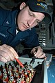 US Navy 050315-N-3390M-278 Electrician's Mate 3rd Class Michael Vanderwalt, troubleshoots a fuse box with a multimeter aboard the guided missile frigate USS Ingraham (FFG 61).jpg