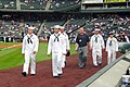US Navy 050510-N-2468E-001 Sailors assigned to the amphibious dock landing ship USS Denver, Navy Recruiting District Denver and Naval Security Group Denver walk on to Coors Field for the opening ceremony.jpg