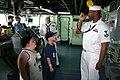 US Navy 050613-N-8110K-017 Boatswain's Mate 1st Class Dwayne Lawson demonstrates the bos'n whistle to children from the Spaulding Rehabilitation Hospital, aboard USS Shreveport (LPD 12).jpg
