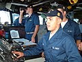 US Navy 050804-N-8825R-015 Midshipman 1st Class Christopher Pieschl trains as Conning Officer on the bridge of the guided-missile frigate USS Ford (FFG 54).jpg