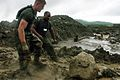 US Navy 060222-N-6274T-123 U.S. Marines assigned to the 31st Marine Expeditionary Unit (MEU), Echo Company, 2nd Battalion, 5th Marines, move rocks, boulders and mud to make a bridge over a river,.jpg