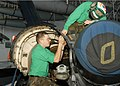 US Navy 060420-N-1891M-005 Aviation Structural Mechanic Airman Paul Pasley, left, and a fellow Sailor perform routine phase maintenance on an F-A-18C Super Hornet.jpg