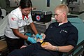 US Navy 060531-N-3931M-035 Jennifer E. Marcos, a medical technician and chapter service representative for the Philippine National Red Cross, draws blood.jpg