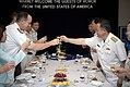 US Navy 070620-N-0696M-483 Chief of Naval Operations (CNO) Adm. Mike Mullen toasts at a dinner hosted by Vietnamese People's Navy Vice Adm. Pham Ncoc Phin during a visit to Hai Phong, Vietnam.jpg