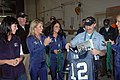 US Navy 071109-N-7431W-001 Aviation Ordanceman 2nd Class Mario Caracciolo is presented with an Seattle Seahawks fan jersey and other prizes by three of the Seahawks cheerleaders.jpg