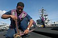 US Navy 081107-N-7730P-021 Aviation Boatswain's Mate (Fuels) 1st Class Antonio Osorio tightens a hydrostatic test cap onto the end of a flight deck of the Nimitz-class aircraft carrier USS Ronald Reagan (CVN 76).jpg