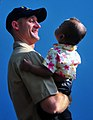 US Navy 090220-N-4774B-001 Lt. j.g. Jarrod Johnson holds a small child during a Project Handclasp community relations event.jpg