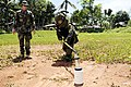 US Navy 090321-N-7130B-095 Chief Explosive Ordnance Disposal Technician Kenneth Simpson watches as a member of the Armed Forces of the Philippines Army Explosive Ordnance Disposal Unit places an explosive tool.jpg