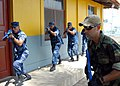 US Navy 090401-N-4143O-002 Nicaraguan Sailors and Marines practice securing a building during a Southern Partnership Station close quarters battle class as Gunner's Mate 1st Class Ricardo Dapenavazquez monitors their progress.jpg