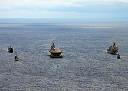 US Navy 090421-N-0120A-206 The forward-deployed amphibious assault ship USS Essex (LHD 2), center, steams in formation