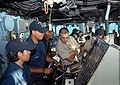 US Navy 090622-A-1839I-031 Boatswain's Mate Seaman Jose Ojeda shows Peruvian Navy Lt. Oscar Regaldo settings on the ships helm during man overboard training aboard the amphibious dock landing ship USS Oak Hill (LSD 51).jpg