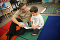 US Navy 090915-N-3271W-052 Personnel Specialist Seaman Johnell Torres of Navy Operational Support Center Reno reads with a student.jpg