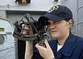 US Navy 091111-N-9520G-002 Quartermaster Seaman Samantha Elwell calculates the range distance as USS Mustin (DDG 89) approaches USNS Rappahannock (T-AO 204).jpg