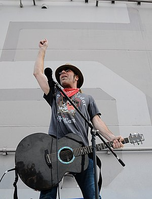 RainSong - Artist, Big Kenny from Big and Rich using a RainSong Guitar in concert