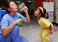 US Navy 100622-N-4044H-013 Kayla Hamrick blows bubbles for a child in the pediatric ward aboard the Military Sealift Command hospital ship USNS Mercy (T-AH 19).jpg