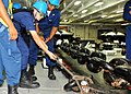 US Navy 100805-N-7334G-006 Seaman Michael V. Ayres, a rigger in the deck department's 1st division, pulls the pelican hook from the anchor chain aboard the aircraft carrier USS Enterprise (CVN 65).jpg