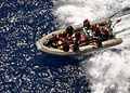 US Navy 100817-N-4649B-024 Sailors assigned to the multipurpose amphibious assault ship USS Bataan (LHD 5) conduct a rigid-hull inflatable boat recovery during a man overboard drill.jpg