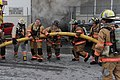 US Navy 110127-N-3478R-108 Firefighters extinguish a warehouse fire at the defense distribution depot at Naval Station Norfolk.jpg