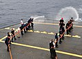 US Navy 110524-N-BK435-148 Sailors and civilian mariners assigned to the submarine tender USS Frank Cable (AS 40) practice hose handling procedures.jpg