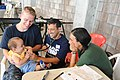 US Navy 110719-F-ET173-304 Midshipman Andrew Marthy, left, from Albany, N.Y., Project Hope volunteer Jeff Cukor, from Worcester, Mass., and Brazili.jpg