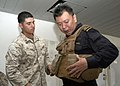 US Navy 110819-N-UU879-115 A Marine helps a Singapore Navy Military Expert with his flak jacket.jpg