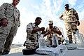 US Navy 111121-N-RP435-093 Explosive Ordnance Disposal Technician (EOD) 1st Class Thomas Hensen observes Royal Bahrain Navy divers and Royal Bahrai.jpg