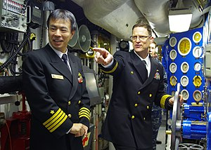 US Navy 111222-N-TX154-056 Capt. Mike Wettlaufer gives a tour to Japan Maritime Self-Defense Force officers.jpg