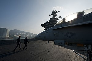 US Navy 111227-N-DR144-126 Sailors transit the flight deck.jpg