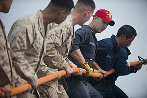 US Navy 120105-N-PB383-979 A Sailor demonstrates how to properly handle a hose during a damage control training exercise.jpg