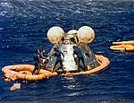 US Navy divers with the ASTP Apollo command module during its recovery S75-29715.jpg